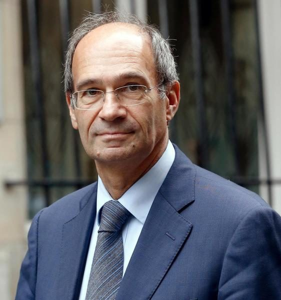 (FILES) - This picture taken on October 3, 2013 in Paris shows Former Budget minister Eric Woerth leaving the French Constitutional Council. Woerth, nearby city of Chantilly's mayor, was summoned on October 24, 2013 to the Court of Justice of the Republic who is investigating the controversial sale of the Racecourse in 2010.          AFP PHOTO / THOMAS SAMSON